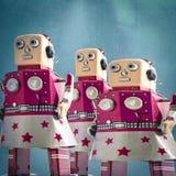 Three girl robot toys looking forward,. Toned image Stock Photo