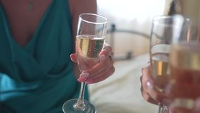 Three girlfriend girls clink glasses of champagne. Touching moment. Pleasant meeting stock video