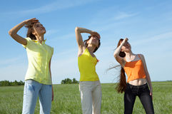 Three girlfriend in green field Stock Images