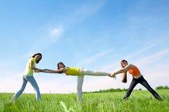 Three girlfriend in green field Stock Photography