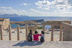 Three girlfriends on the acropolis of Lindos Royalty Free Stock Photos