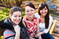 Three girlfriends on bench Royalty Free Stock Image