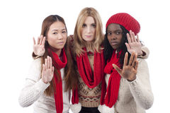 Three girlfriends with different derivation hold their hands in Stock Images