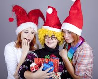 Three girlfriends in funny hats Royalty Free Stock Photography