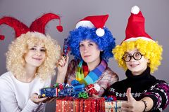Three girlfriends in funny hats Stock Photography