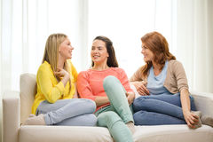 Three girlfriends having a talk at home Stock Photography