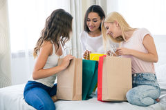 Three girlfriends with many shopping bag Stock Photos