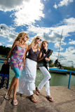Three girlfriends in the port Royalty Free Stock Photography