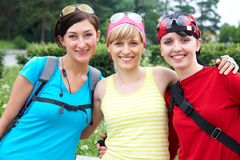 Three girlfriends in sports clothes Royalty Free Stock Photo