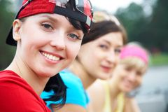 Three girlfriends in sports clothes Stock Photos
