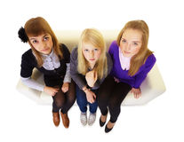 Three girlfriends teen on the couch Royalty Free Stock Image