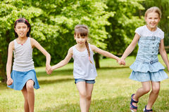 Three girls as friends Stock Image