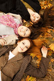 Three girls in the autumn park. Stock Images