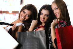 Three girls with bags Royalty Free Stock Photos