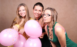 Three girls with balloons Stock Photos