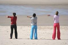 Three girls in the beach Stock Image