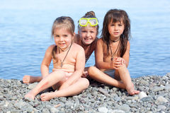 Three girls on the beach. Against the sea Stock Images