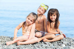 Three girls on the beach. Against the sea Stock Image