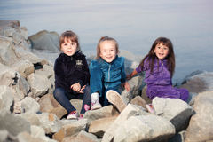 Three girls on the beach Stock Photo