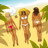 Three Girls on the Beach. Three beautiful girls in bikini near palm trees lie on the beach and sunbathing Stock Photo