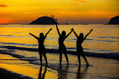 Three girls on the beach. At sunset Stock Image