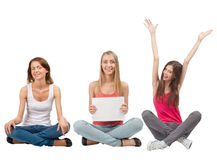 Three girls with blank signboard Royalty Free Stock Photography