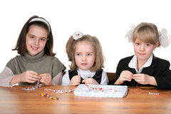Three girls busy with handicraft Royalty Free Stock Photography