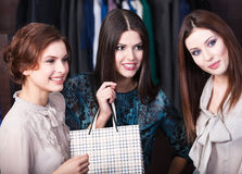 Three girls are in the store Royalty Free Stock Images