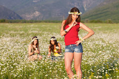 Three girls on camomile field Royalty Free Stock Photos