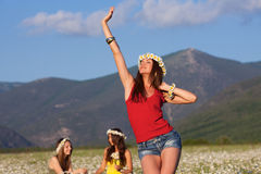 Three girls on camomile field Royalty Free Stock Images