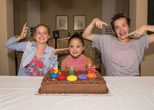 Three girls celebrating their birthdays. A Thirteen year-old girl, and eight year-old girl, and a fifteen year-old teenage girl celebrating their birthday.  They Royalty Free Stock Image