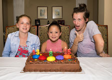 Three girls celebrating their birthdays. A Thirteen year-old girl, and eight year-old girl, and a fifteen year-old teenage girl celebrating their birthday.  They Stock Photography