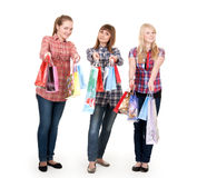 Three girls with colorful shopping bags Stock Image