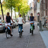 Three Girls Cycling in Amsterdam Royalty Free Stock Images