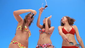 Three girls dancing together in bikinis stock video footage
