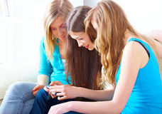 Three girls with digital camera Stock Photos