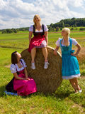 Three girls in Dirndl. Three happy, beautiful girls in dirndl royalty free stock photo