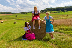 Three girls in dirndl. Looking having fun royalty free stock photos