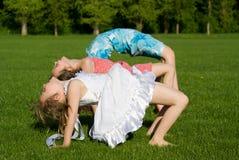 Three girls doing exercises Royalty Free Stock Image