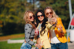 Three girls are doing selfie in the Park Stock Image