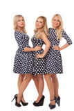 Three girls in dot dresses and black shoes Royalty Free Stock Photo