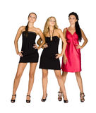 Three girls in dresses. Snapshot of three women in black and red dress with a gray background with illumination Stock Photography