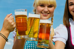Three girls drinking beer Royalty Free Stock Image