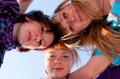 Three girls are embracing Royalty Free Stock Photo