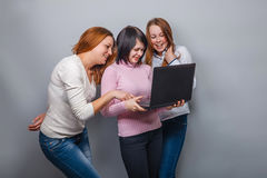Three girls European appearance girlfriend working Royalty Free Stock Images