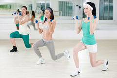 Three girls in fitness club Royalty Free Stock Photography