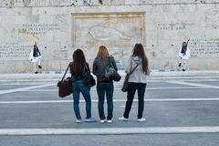 Three girls in front of the Unknown soldier tomb Royalty Free Stock Image