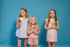 Three girls girlfriend eat candy lollipop sister stock photo