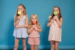 Three girls girlfriend eat candy lollipop sister stock photography