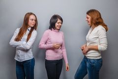 Three girls girlfriends talking  two, one was Royalty Free Stock Photography